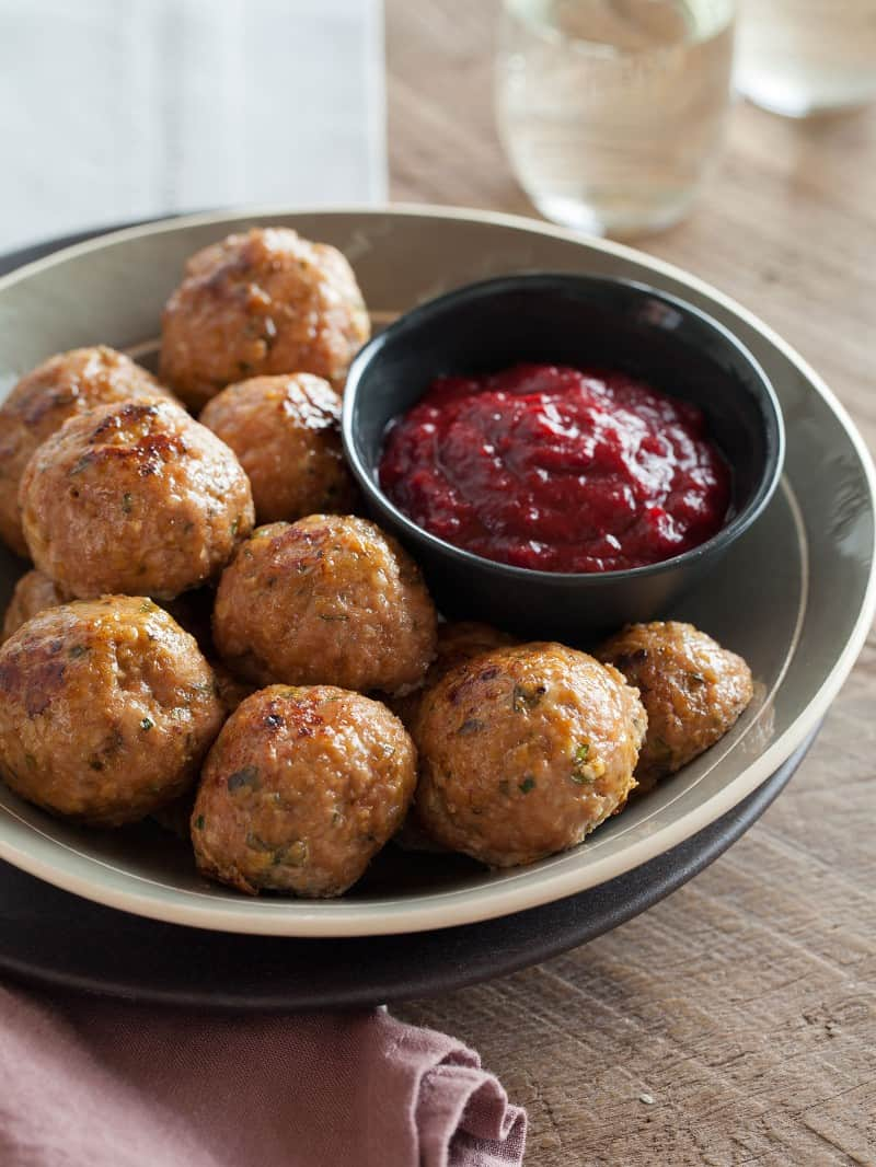 Perfect holiday recipe for Herbed Turkey Meatballs with a Barbecue Cranberry Sauce.
