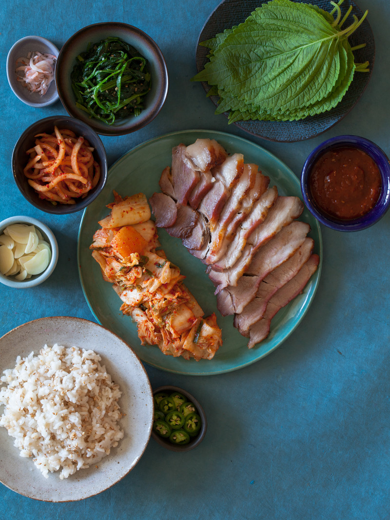Ingredients in bowls and on plates for bo ssam.