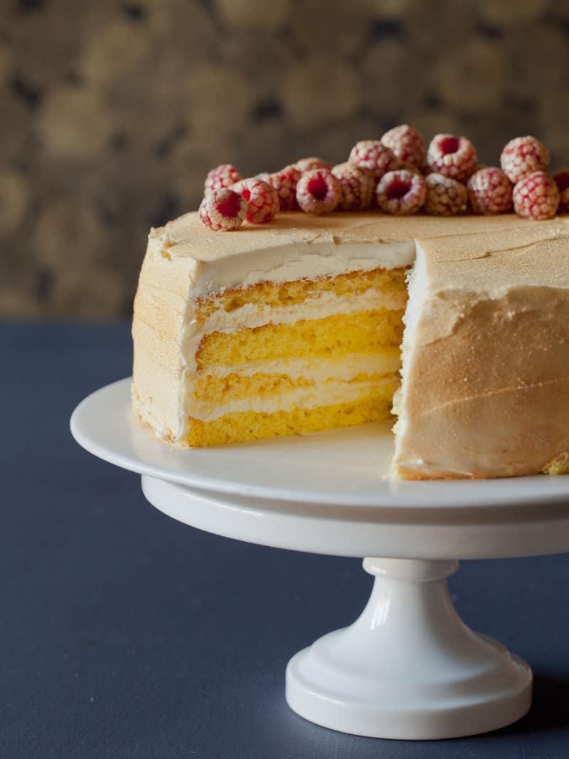 Rose Water Glitter Cake recipe with buttercream and glittered raspberries.