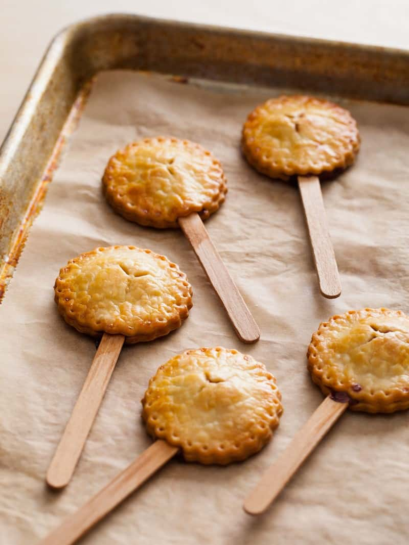 Miniature Peanut Butter and Jelly Pies baked on sticks.