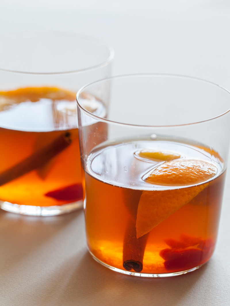 The perfect winter cocktail, a Winter Spiced Old Fashioned with cinnamon, star anise, cardamom, cherries, and orange slices.