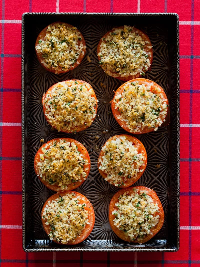 A recipe for Tomatoes baked with parmesan, bread crumbs, and spices.