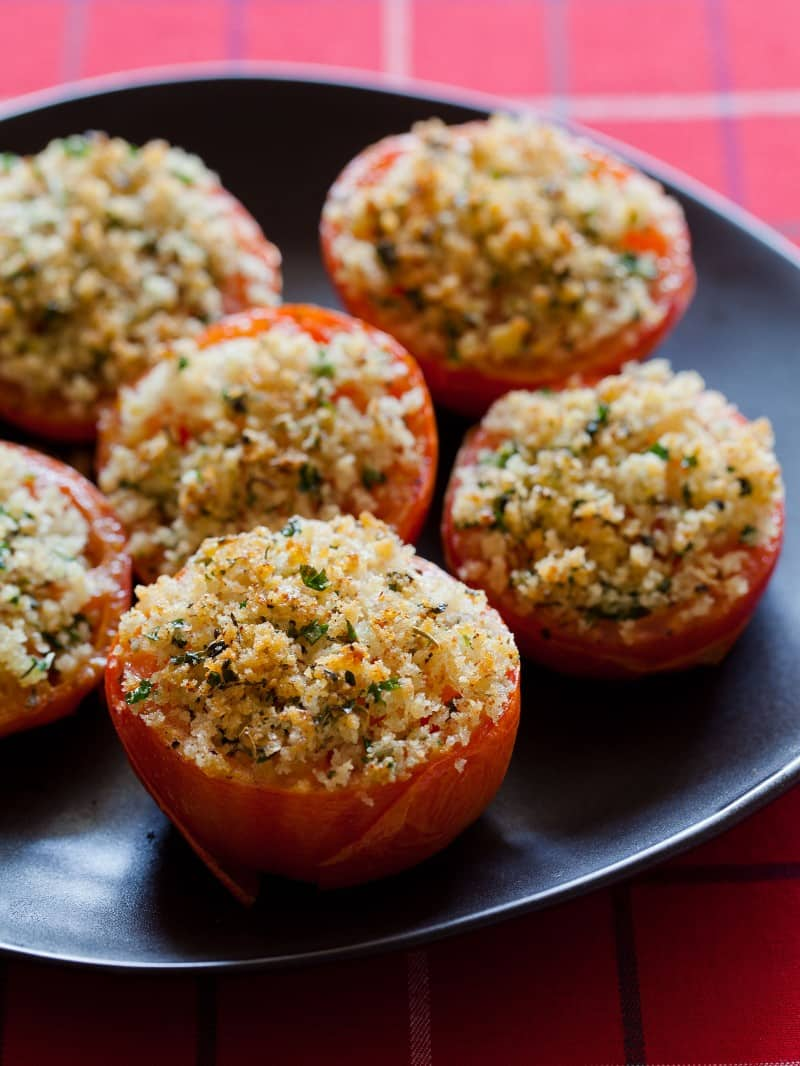 A recipe for baked tomatoes with parmesan and herbs.
