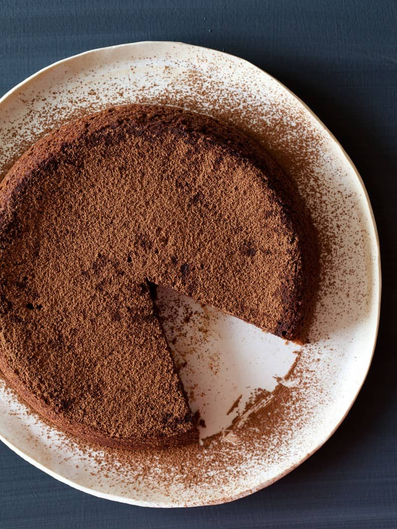 Flourless Chocolate Amaretti Cake topped with cocoa powder.