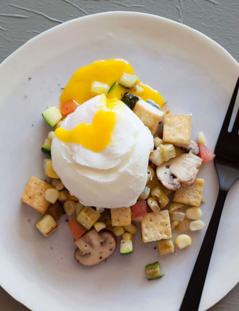 A tofu scramble with a perfectly poached egg.