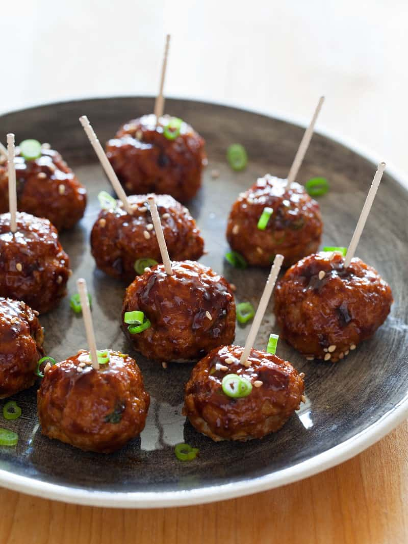 Korean style Cocktail Meatballs topped with green onions.