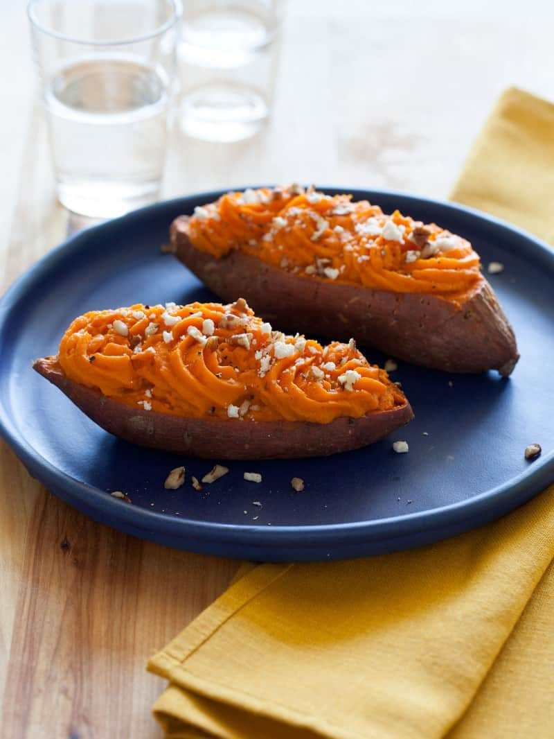 A recipe for Twice Baked Sweet Potatoes topped with feta and pecans.