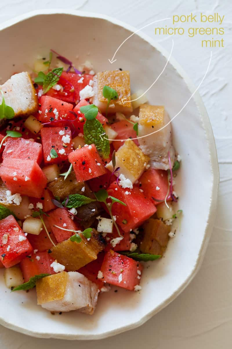A great summer salad with watermelon, feta, mint, cubes of crispy pork belly, and micro greens.