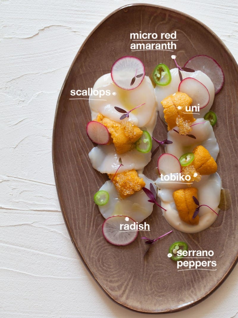 Scallops, uni, radishes, tobiko, seranno peppers, micro red amaranth, all ingredients for Scallop and Uni Crudo.