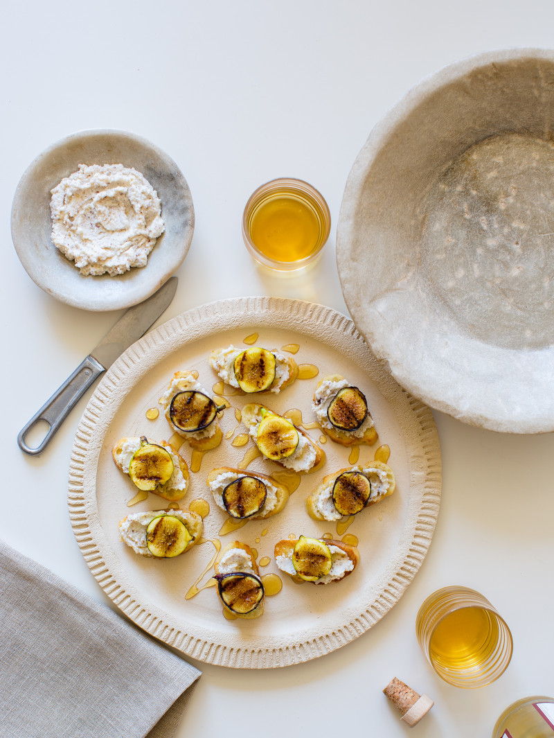 A perfect appetizer recipe for Fig Hazelnut Ricotta Crostinis.