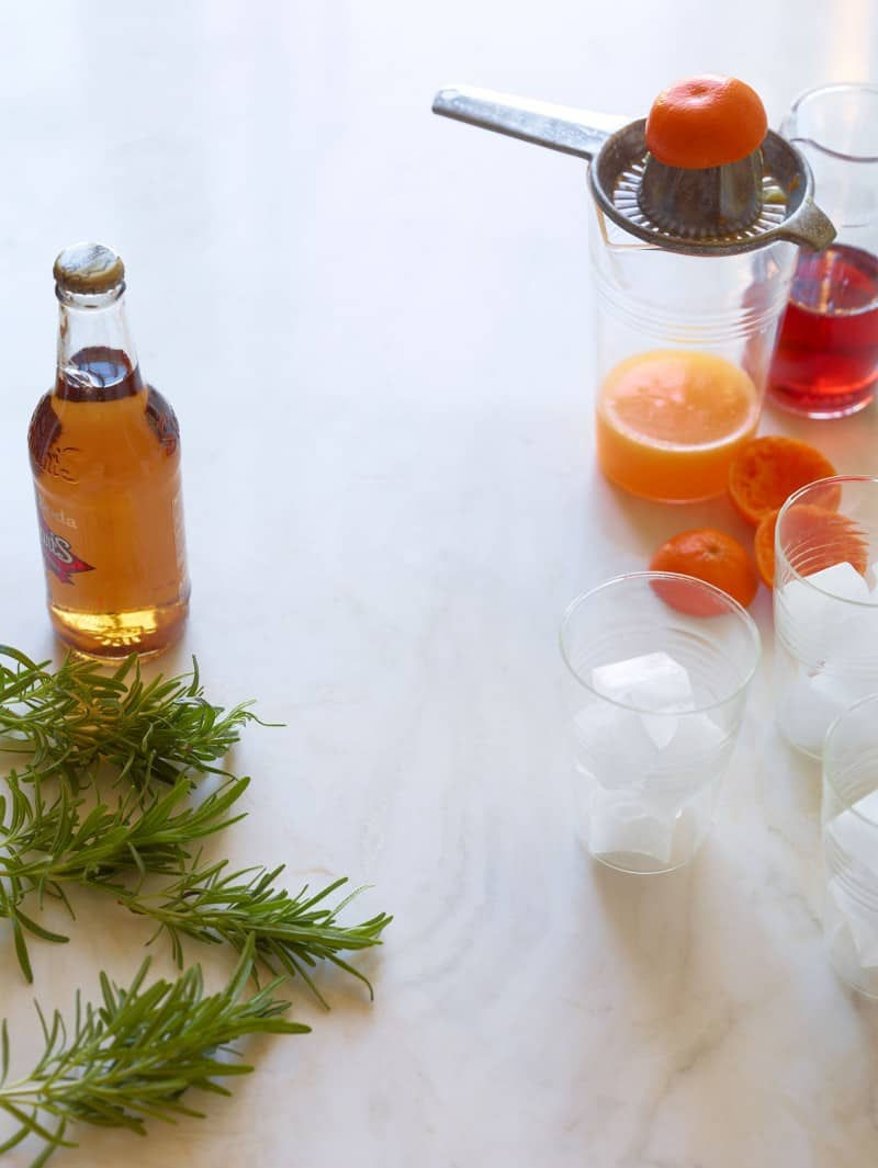 Ingredients for a Cranberry Tangerine Rosemary and Cream Soda Mocktail.