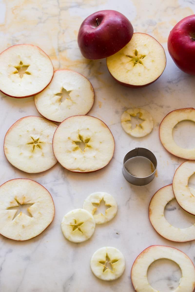 Thin slices of apples cut our for a Honeycrisp and Bourbon Spiced Cider cocktail recipe.
