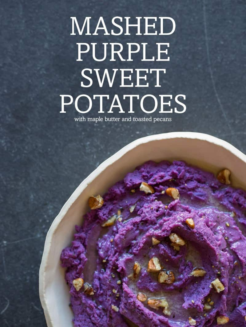 Mashed Purple Sweet Potatoes topped with butter and toasted pecans.