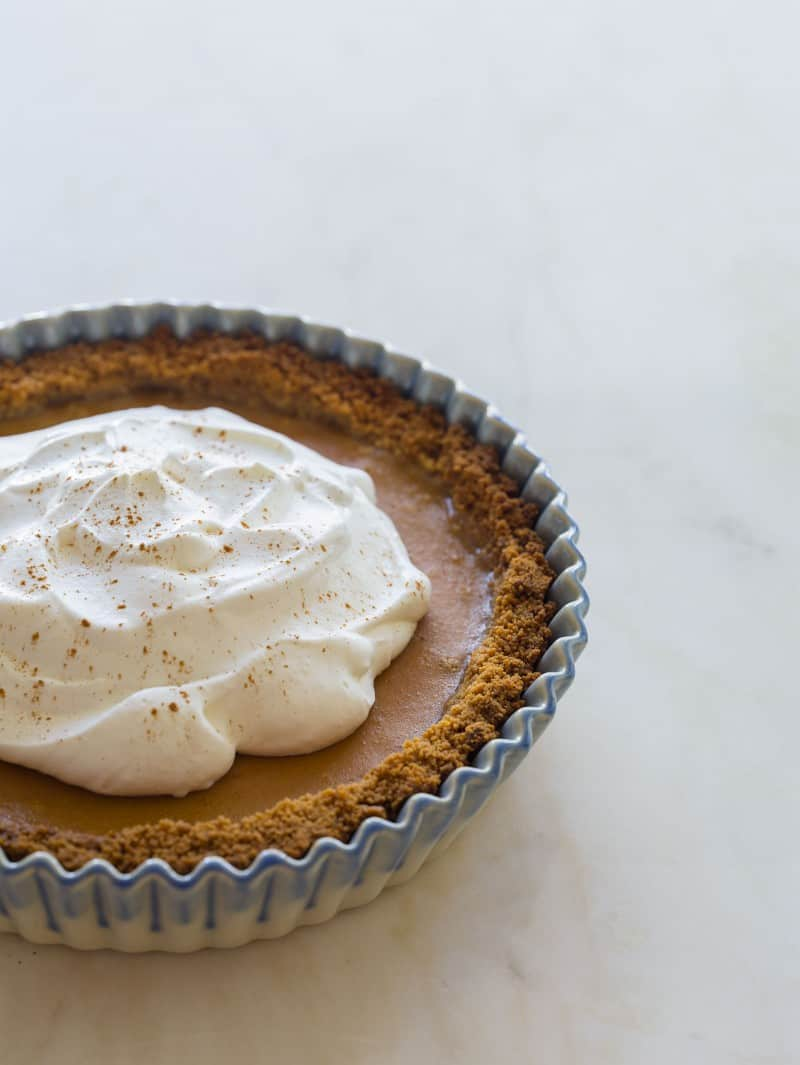 Spiced Butternut Squash Pie recipe topped with whipped cream.
