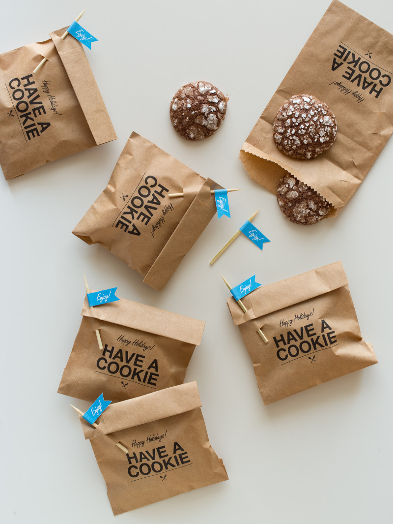 "Cookie gift bags with ""enjoy\"" labeled pick closures and homemade cookies."