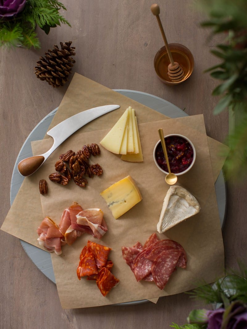 Elements to make a perfect cheese board.