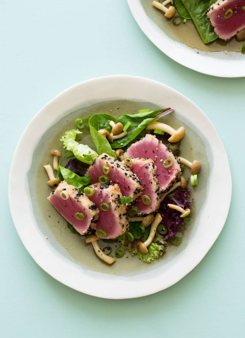 Black Sesame and Almond Crusted Ahi Tuna over sautéed beech mushrooms and mixed greens.