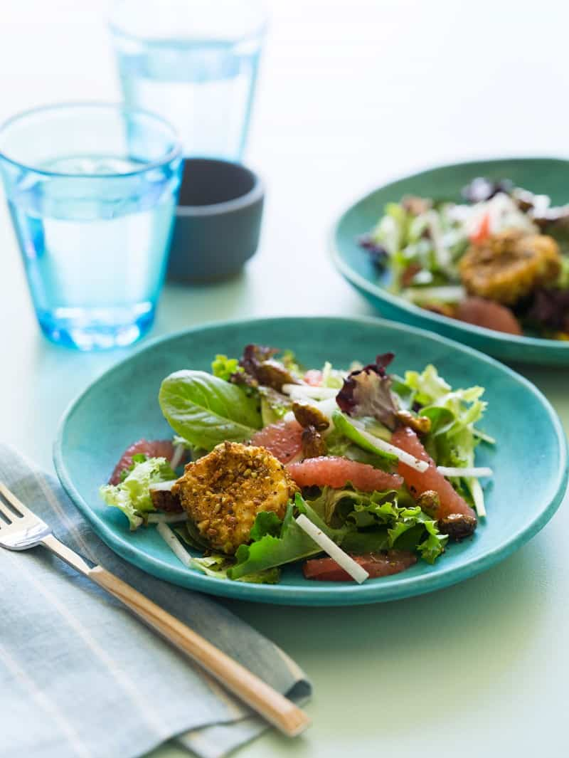 Grapefruit and Mixed Green Salad with pistachio crusted goat cheese rounds.