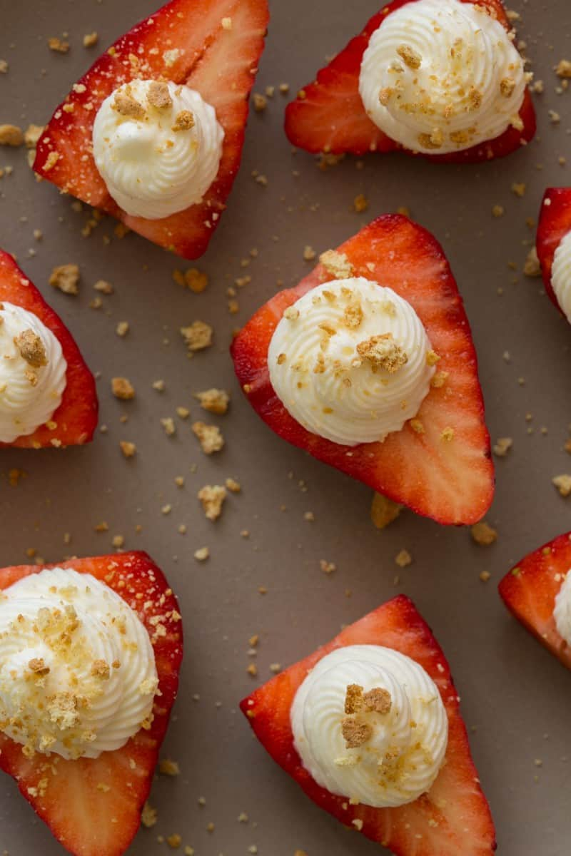 Strawberries stuffed with a cream cheese filling and topped with crumbled graham crackers.