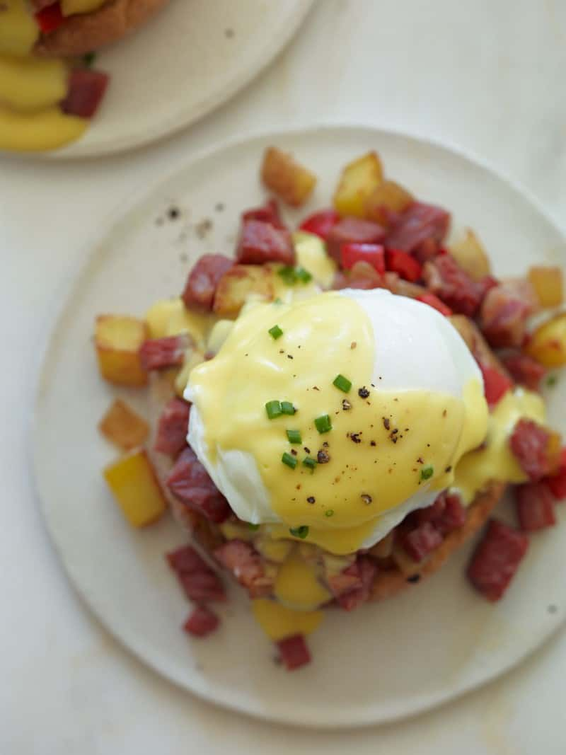 Corned Beef hash on an English muffin with an over easy egg and hollandaise sauce.