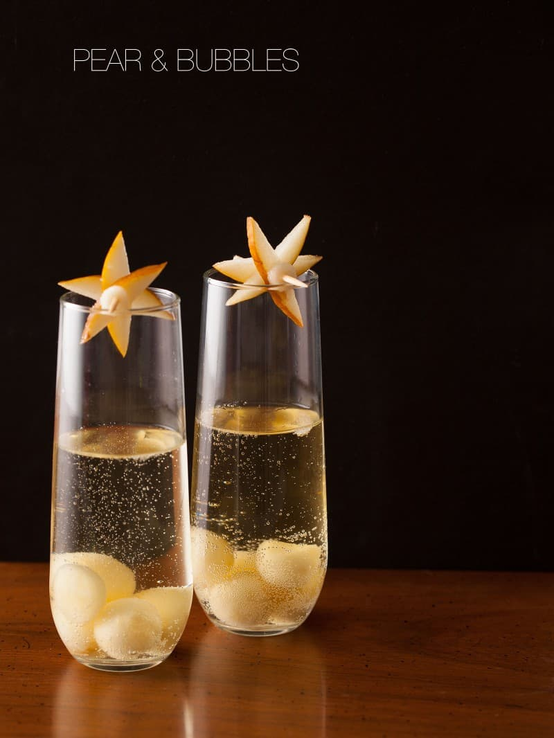 A recipe for Pear and Bubbles, a cocktail with pear puree and champagne.