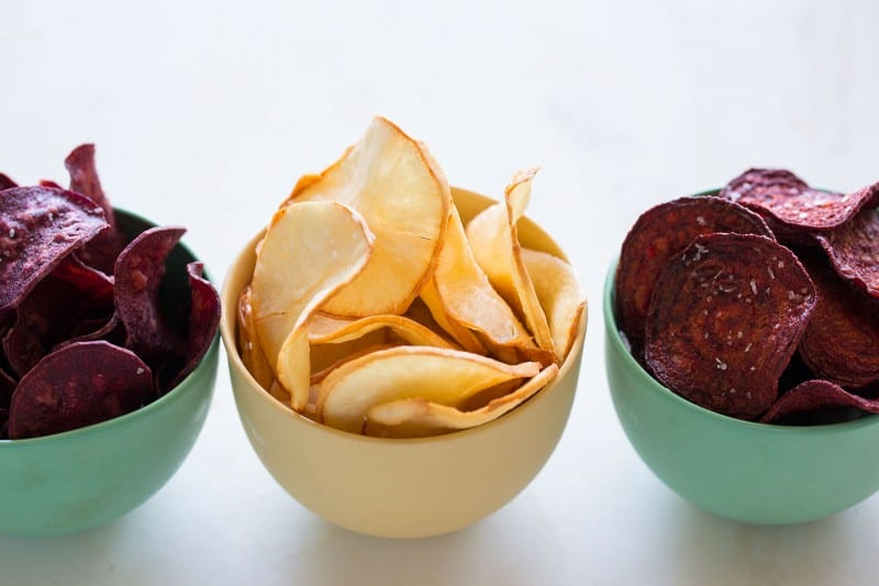 Yucca, purple sweet potatoes, and beets slices made into chips with salt.