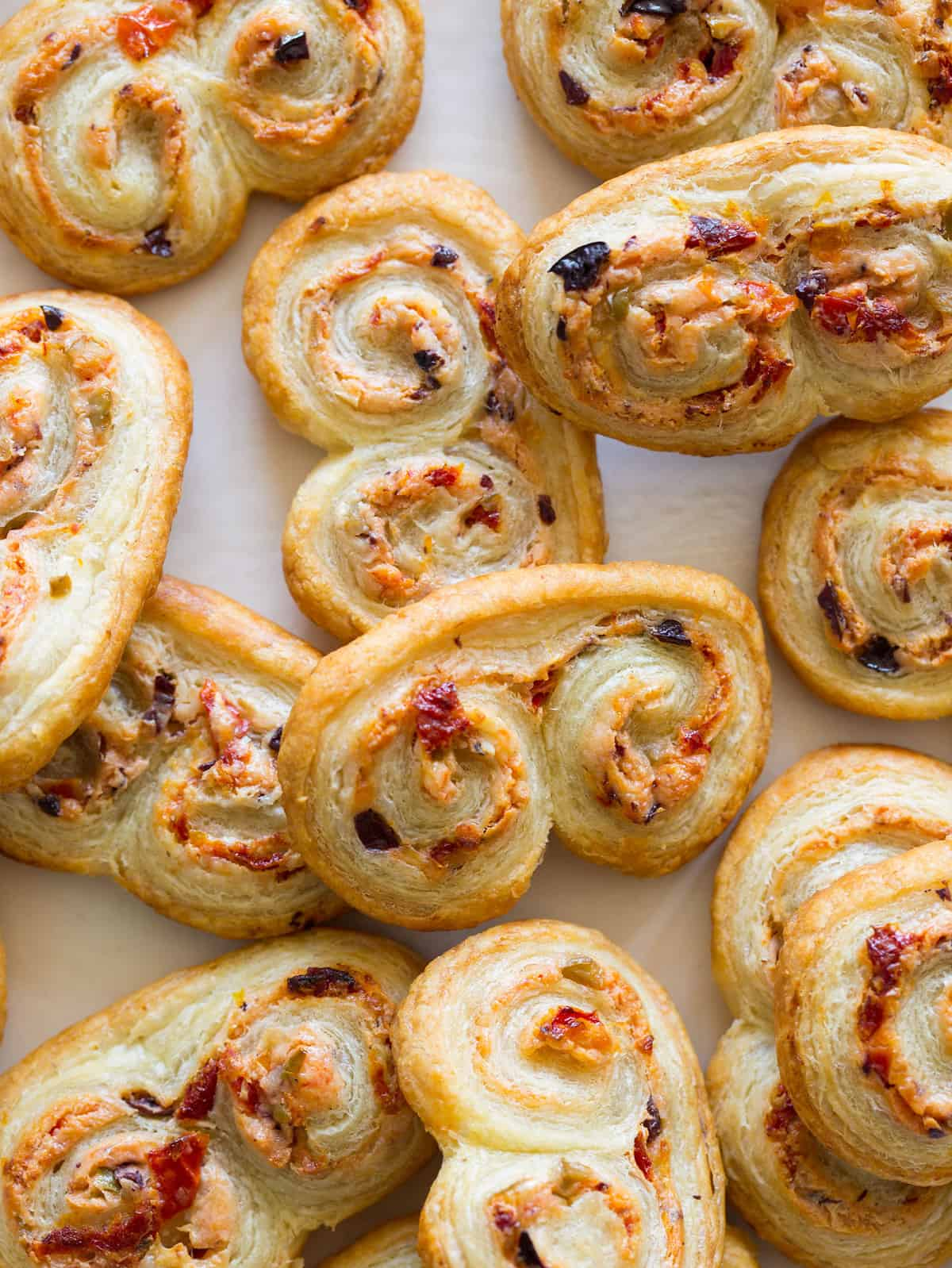 Sun dried tomato olive goat cheese palmiers spoon fork - Image palmier ...