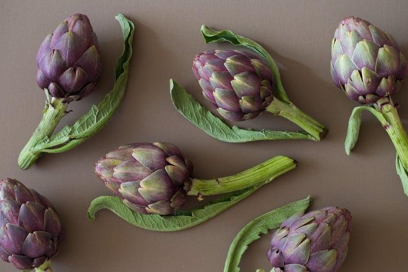 A close up of fresh raw artichokes.