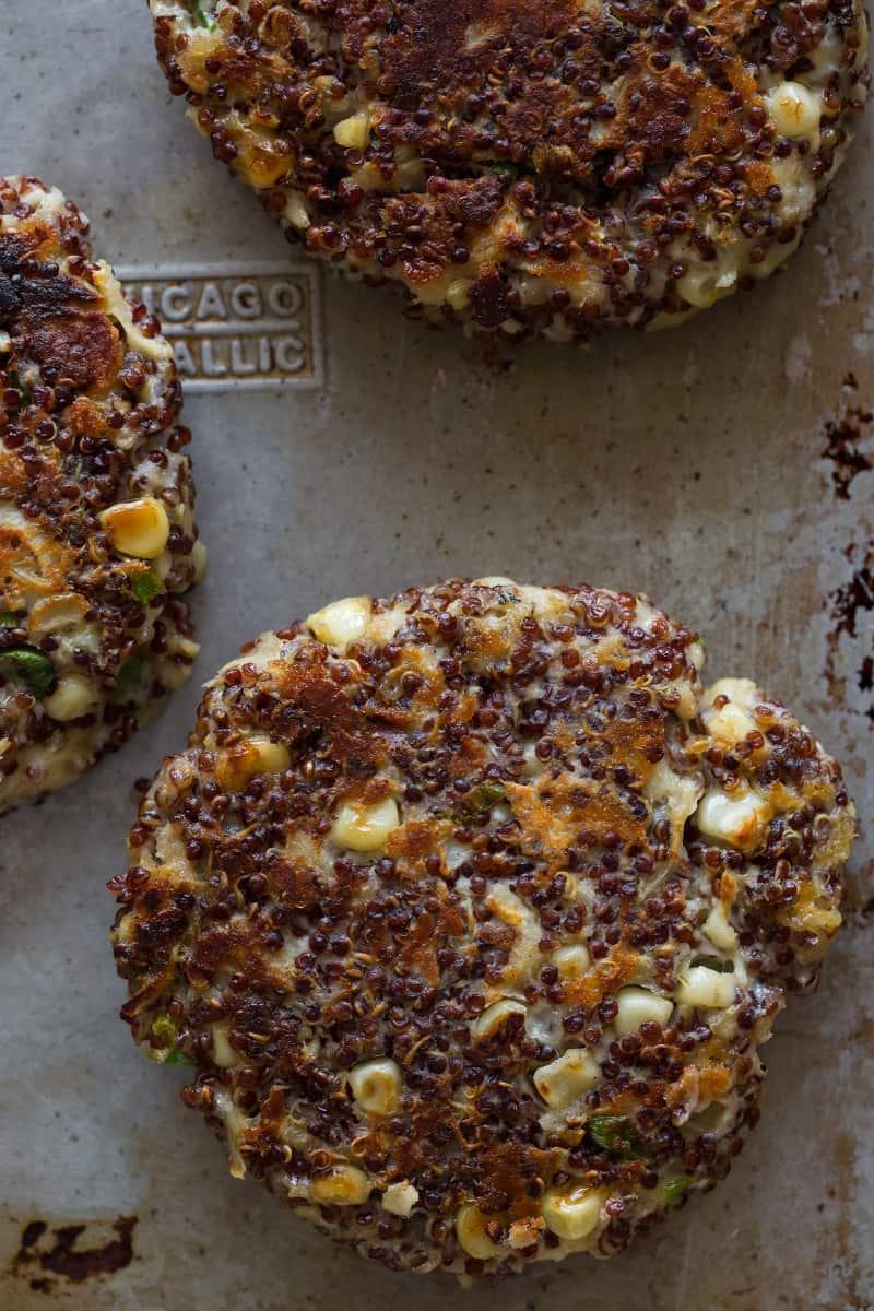 A close up of several big veg quinoa burger patties.