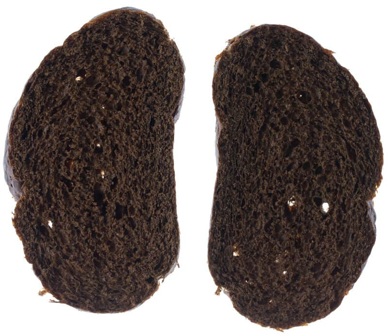 A close up of two pieces of rye bread.