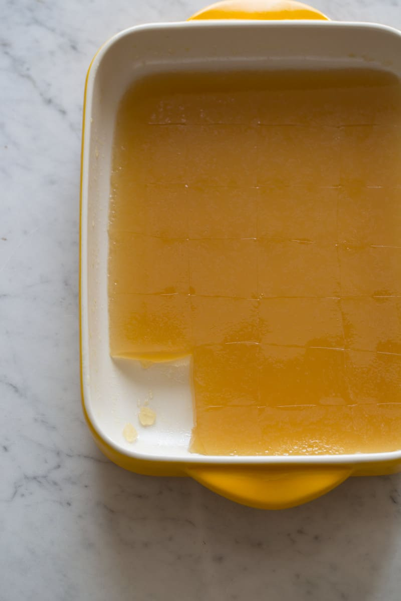 A pan of gelatinized stock with a square cut out.