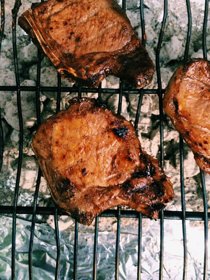 A close up of pork on a grill.