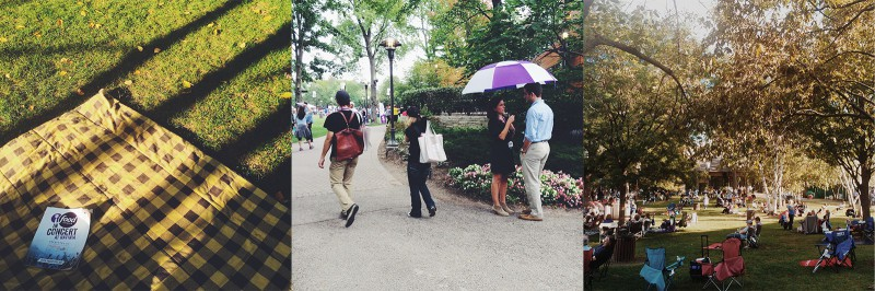 A group of people walking down a sidewalk holding an umbrella.