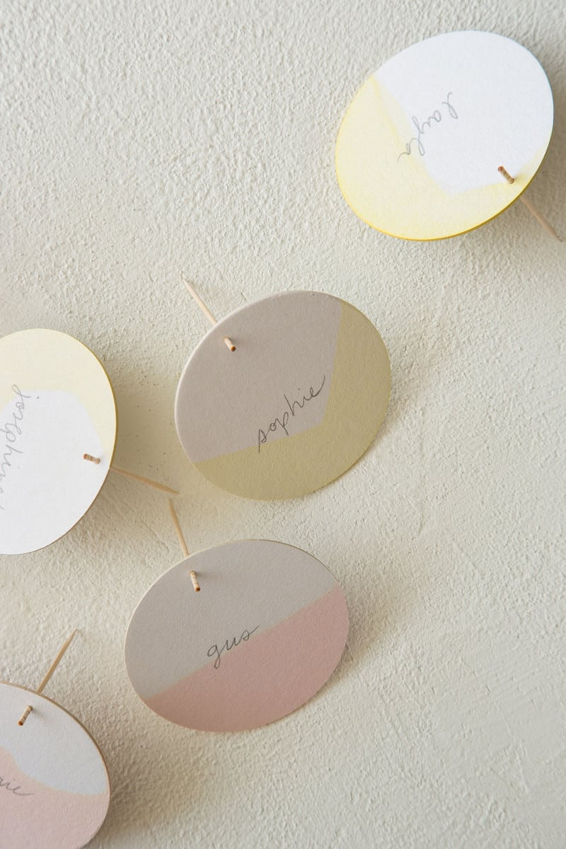 DIY dip dye place cards standing up with toothpicks.