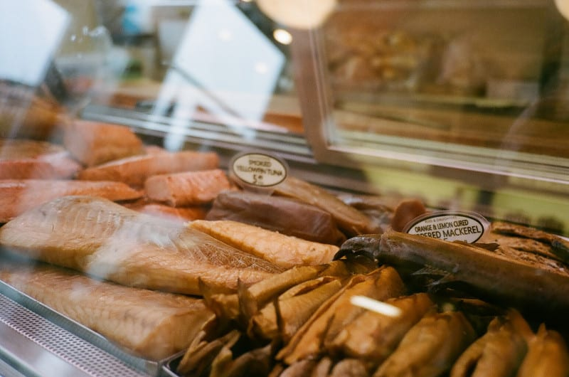 A close up of cured fish in a display case.
