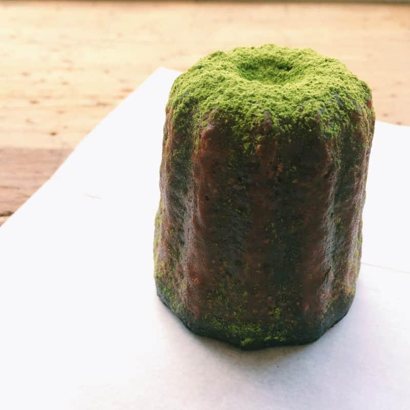 A close up of a matcha canele.