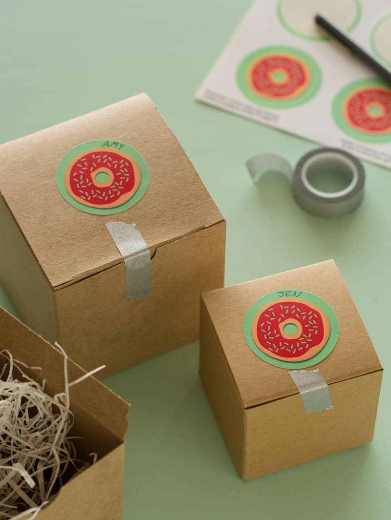 Doughnut printable food gift tags on gift boxes with tape.
