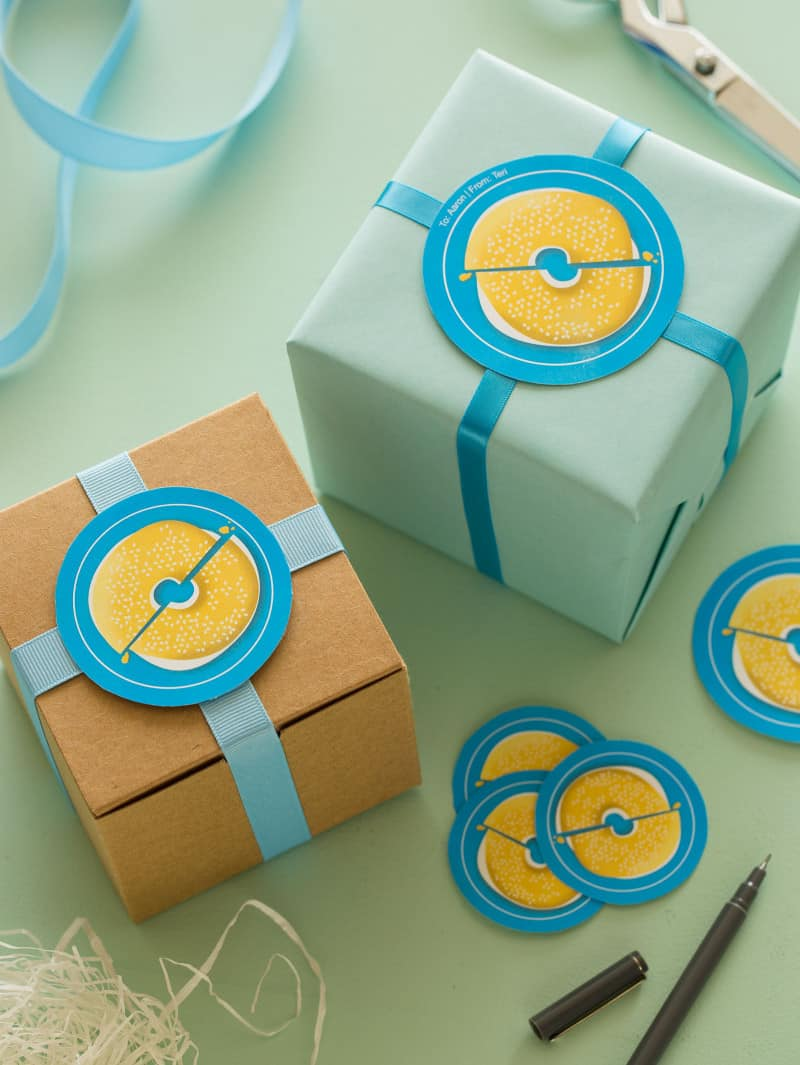 Blue bagel printable food gift tags on gift boxes.