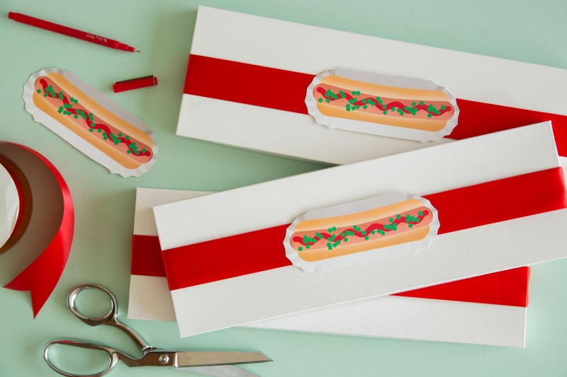 Hotdog printable food gift tags on gift boxes with scissors.