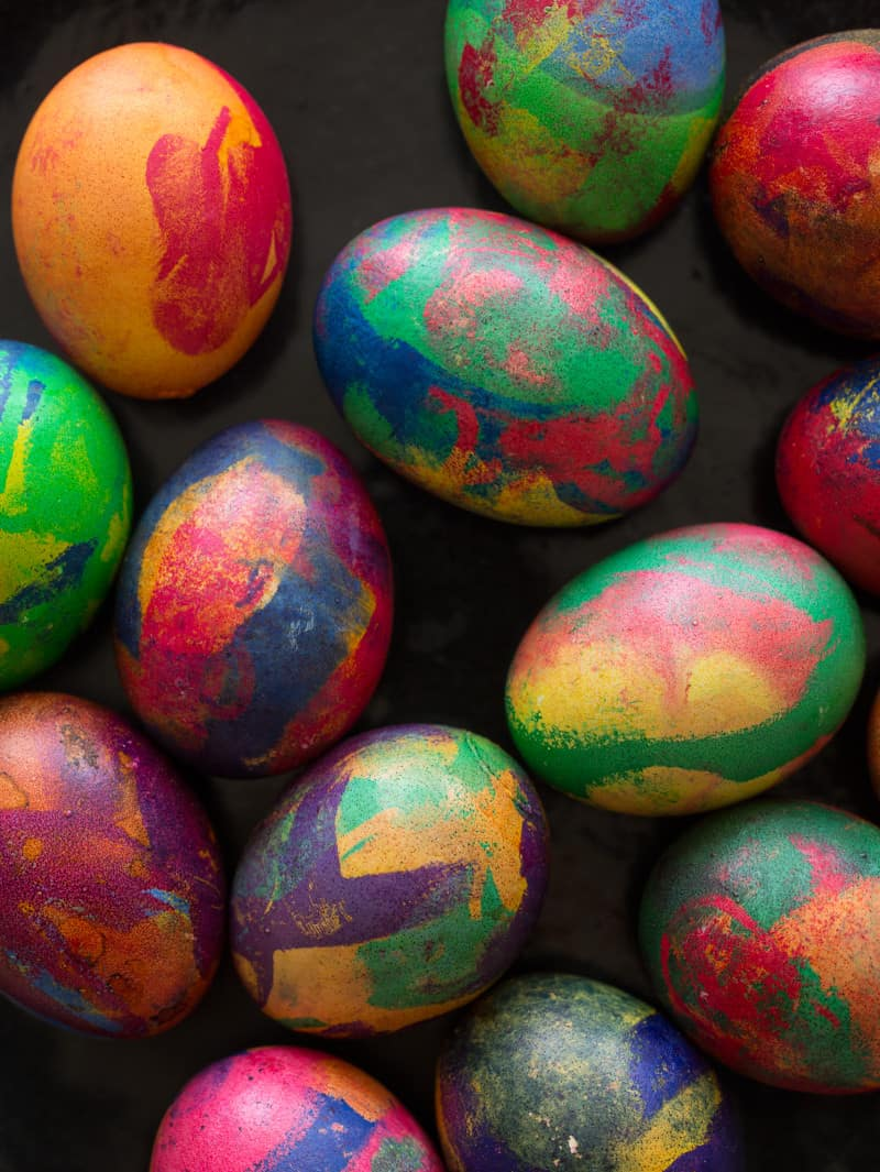 A close up of colorful painterly dyed Easter eggs.