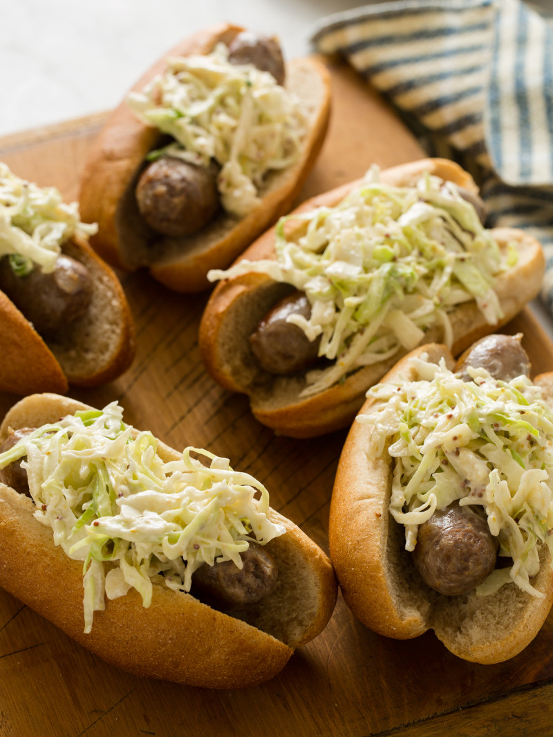 Creamy Whole Grain Mustard Slaw Topped Bratwursts
