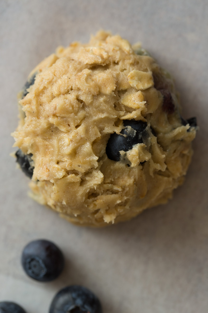 A close up of blueberry and cardamom oat cookies dough ball.