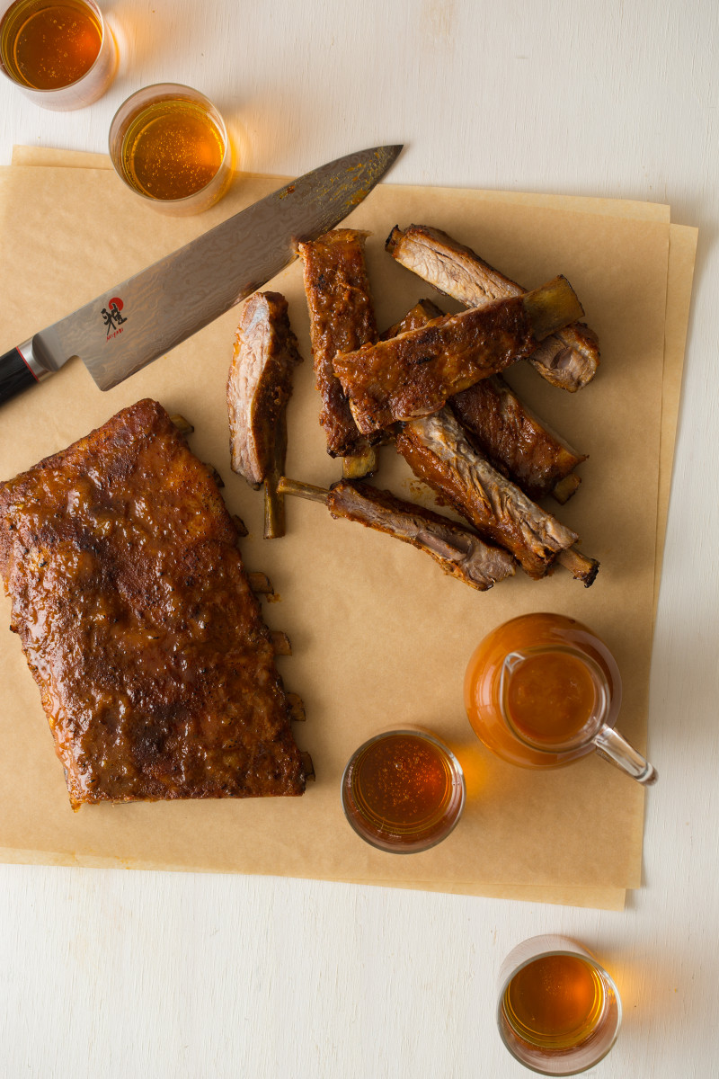 Habanero glazed spare ribs rub up on pieces of parchment.