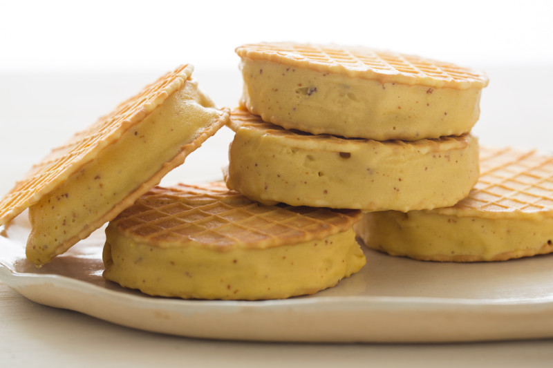 A close up of stacked browned butter ice cream sandwiches.