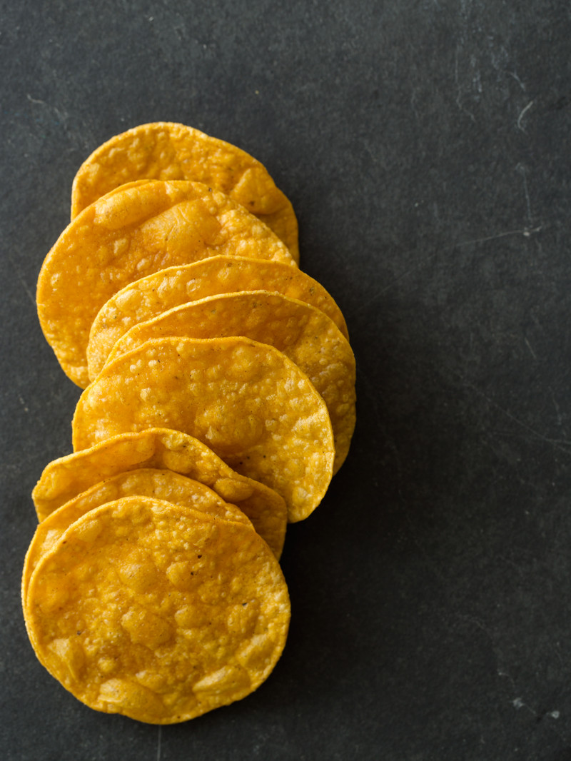 Tostadas stacked and lined up.