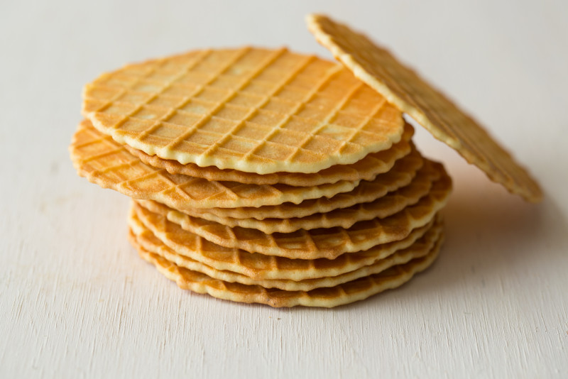 A close up of stacked waffle discs.