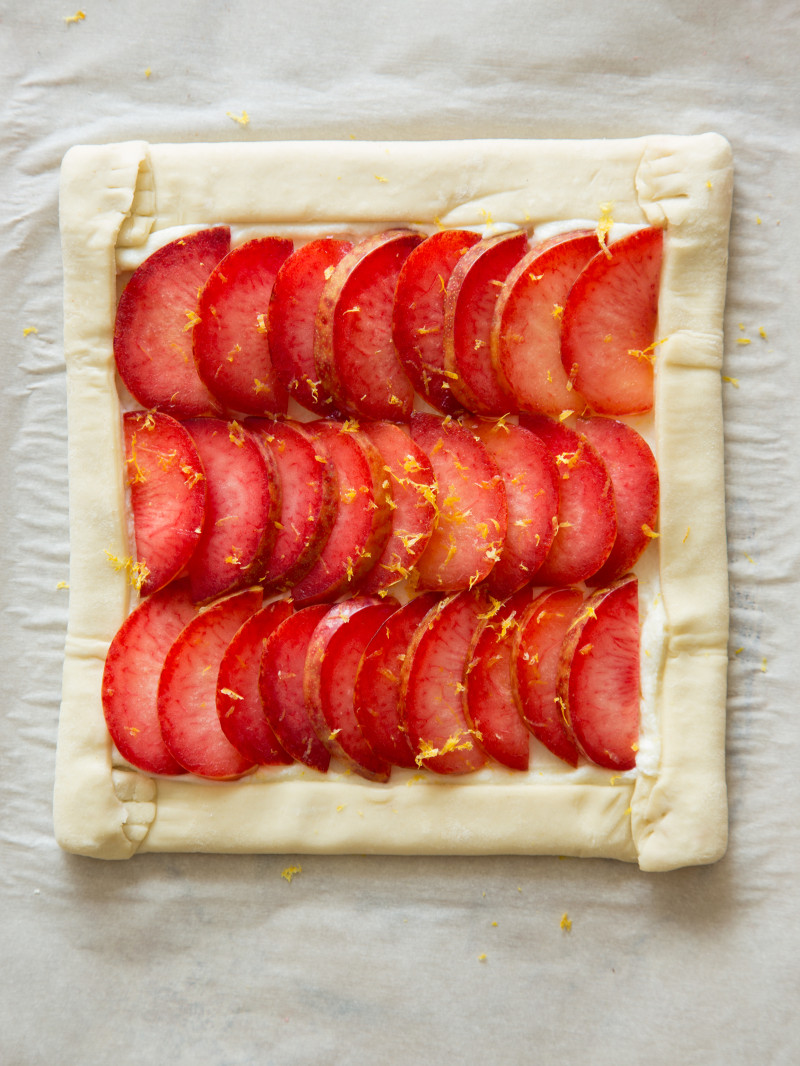 A stone fruit tart assembled and ready for baking.