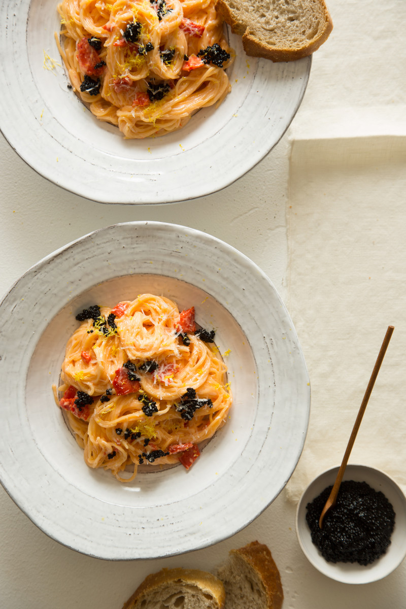 Bowls of capellini with a smoked salmon cream sauce.