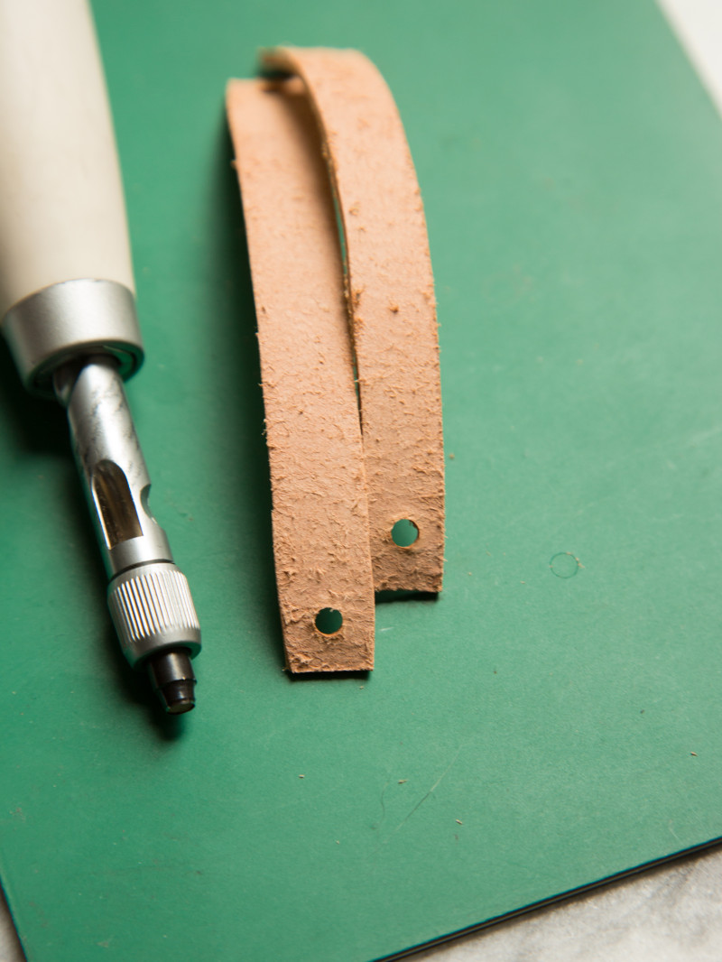 Leather strips with holes punched in the ends and a screw punch tool.