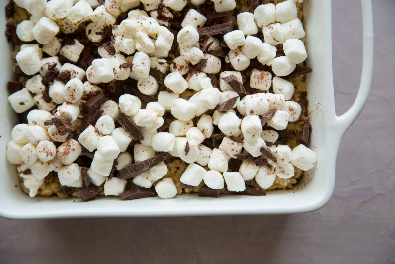 A close up of s\'mores rice krispies treats in a baking pan.